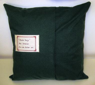 The back of the cushion, with label and double-layer back with invisible fastening.