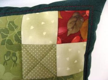 A detail of a corner of the Blackfor Beauty cushion, showing the quilting in the border.