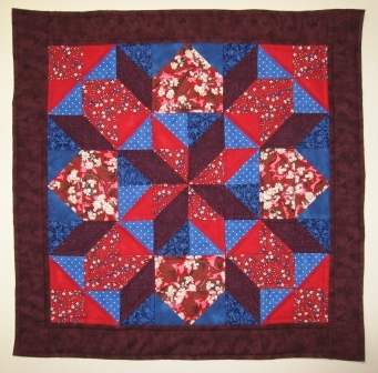 The quilted block, prior to adding the cushion back