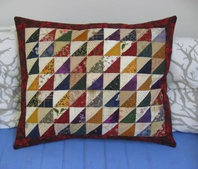 The finished cushion, sitting on the daybed in my studio