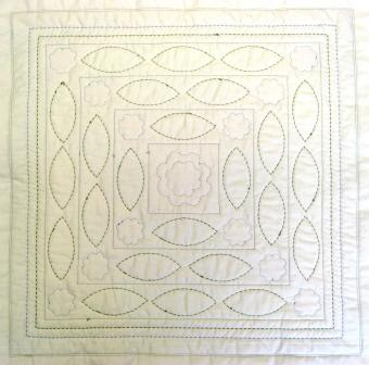 The back of the quilt sandwich, showing the quilting pattern