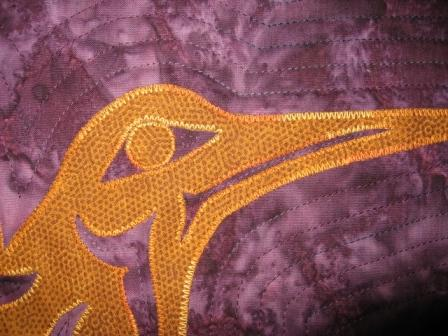 Deatil of the quilting round the head of the hummingbird