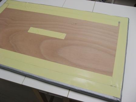The board back with the carpet tape ready for sticking the felt to