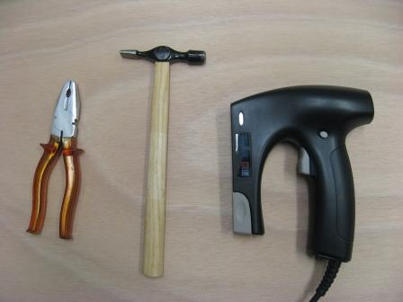 A staple-gun, hammer and pliers