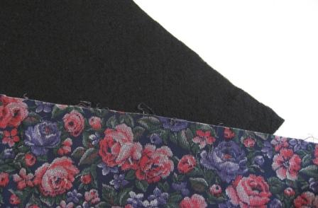 The black Hobbs batting and my faux tapestry cover fabric.