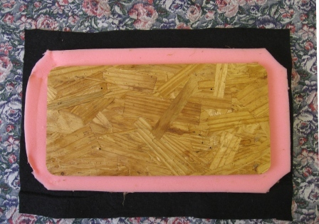 The foam, batting, fabric sandwich, ready for stapling.