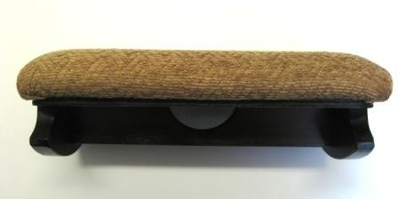 The footstool from the front, showing the carrying handle underneath.