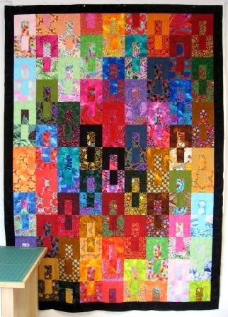Gemini quilt top on the design wall