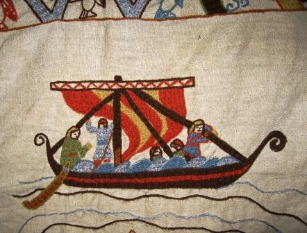 A close up of a Viking ship in the embroidery.