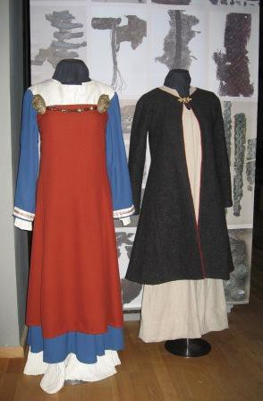 Two styles of womens' Viking Age dress, with genuine fabric survivals mounted behind.