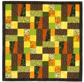 The inner brown border sewed to the central area of the Kansas Troubles quilt top.