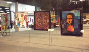 Some of the championship quilts in the main hall.