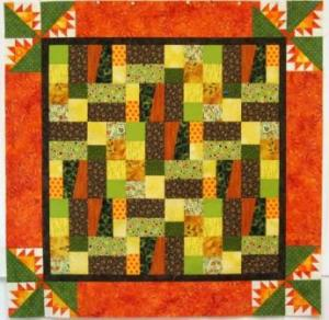 The Kansas Troubles quilt with the second orange border sewn on.