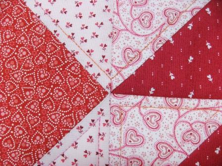 Detail of the pink echo quilting