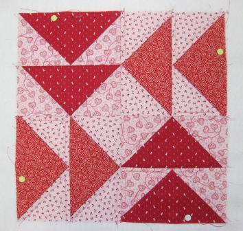 Echo quilting the pale pink squares