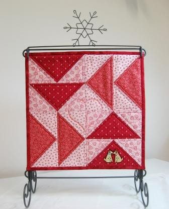 The quilt on the stand