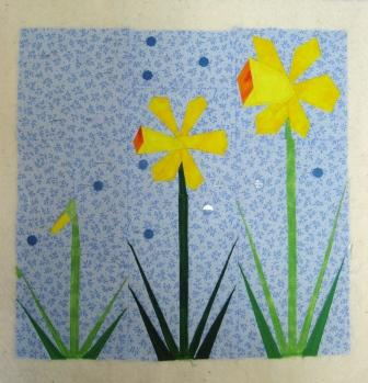 Here the quilting in the daffodils is complete