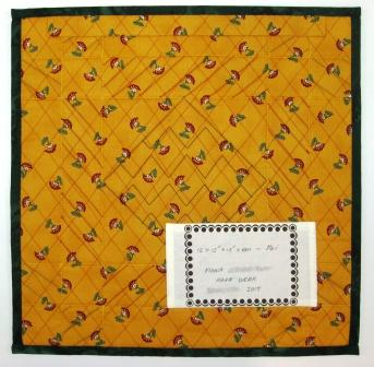The quilt back with label.