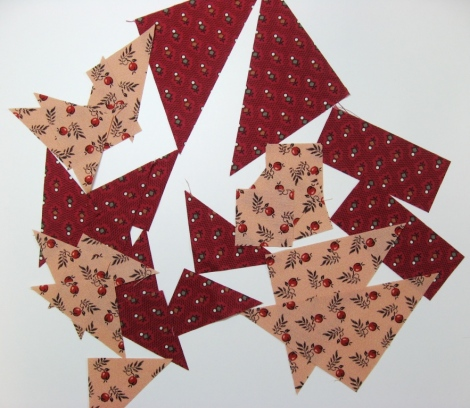 The triangles, cut and ready for piecing.