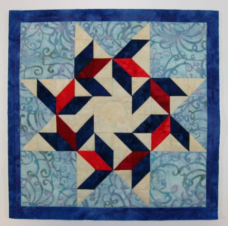 Quilted and trimmed to size.