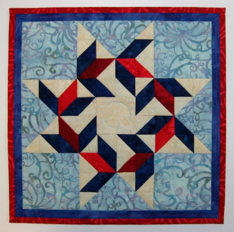 The quilt with binding added.