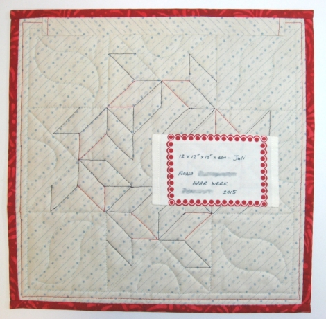 The quilt back. The pattern of the quilting is clearly visible.