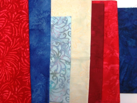 The fabric selection for the July quilt.