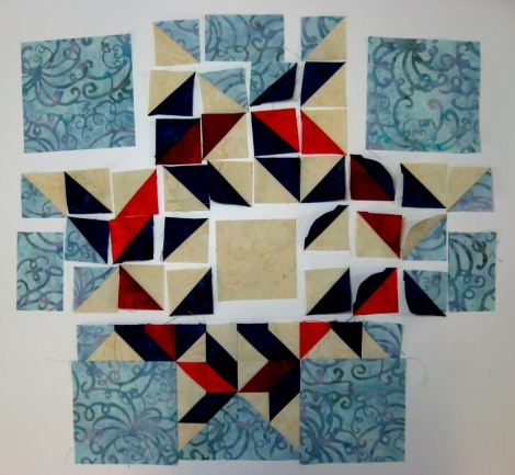 Piecing in progress. The fit problem is visible with the corner squares.