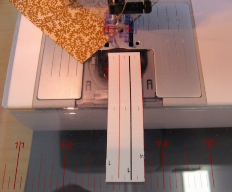 The sticky-baked paper tape in place; the red line leads to the needle.