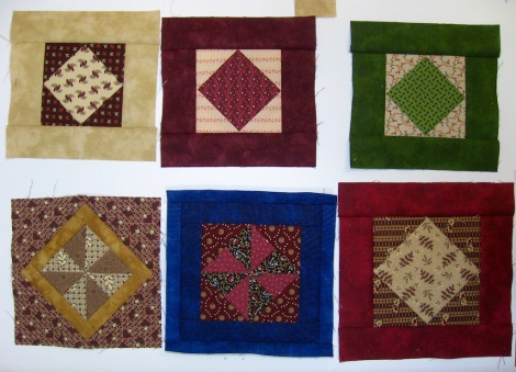 The square in a square with pinwheel blocks and bordered square in a square blocks